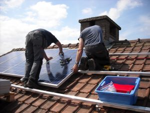 solar panels being installed on a roof top